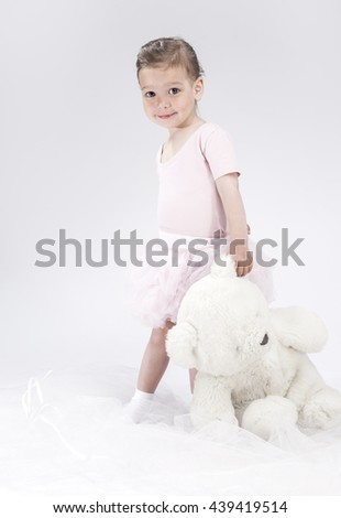 Portrait of Playful Little Caucasian Child. Posing With Big Toy. Vertical Image Composition