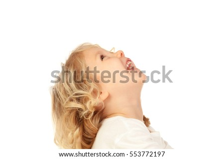 Portrait of playful small kid with long blond hair isolated on white background