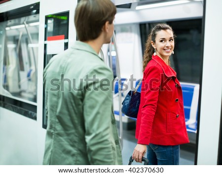 Portrait of playful young people making acquaintance in public transport - stock photo