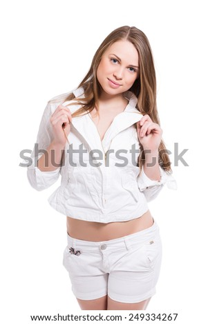 Portrait of playful young woman in white clothes. Isolated on white
