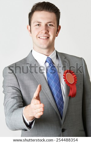 Portrait Of Politician Reaching Out To Shake Hands - stock photo