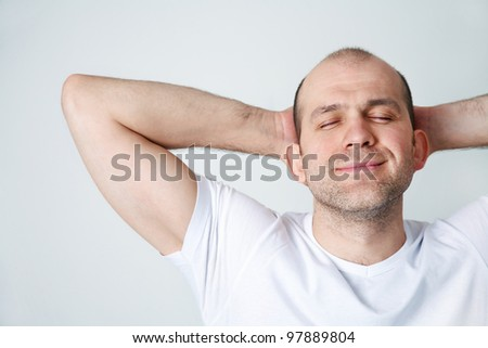 Portrait of positive bald-headed smiling man on white background - stock photo
