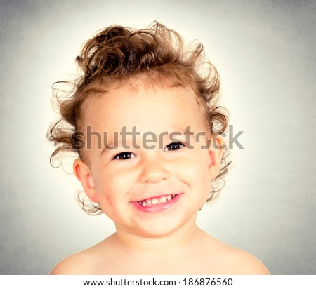 Portrait of positive child with funny hairstyle  - stock photo