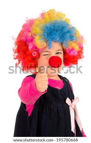 Portrait of positive little clown wit thumb up isolated on white background  - stock photo