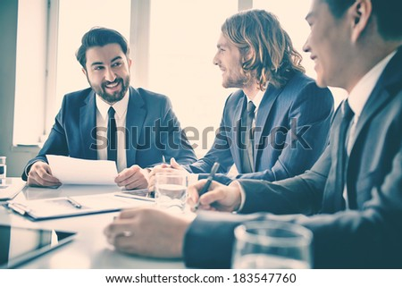 Portrait of positive managers at meeting - stock photo