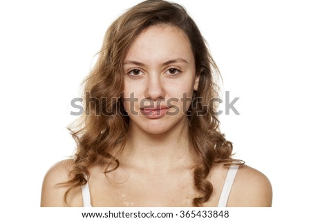 Portrait of positive young woman without make-up - stock photo