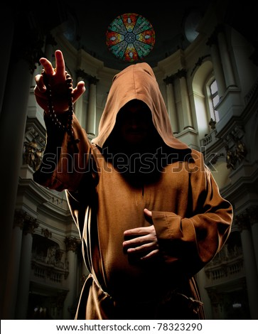 Portrait of preaching medieval monk in church - stock photo
