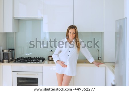 Portrait of pregnant woman in the kitchen
