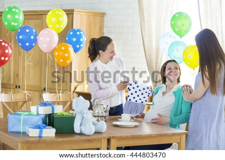 Portrait of pregnant woman with friends at a baby shower