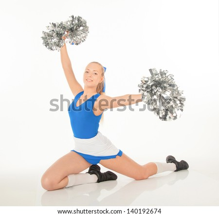 portrait of pretty active young cheerleader