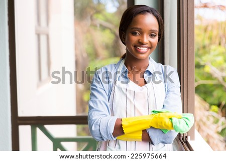 portrait of pretty african woman doing house chores
