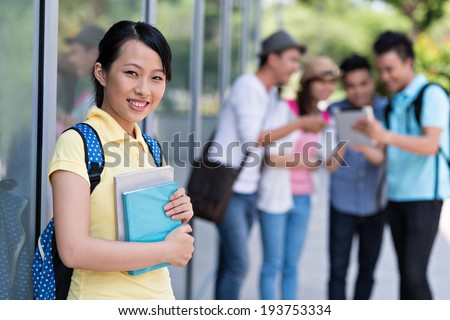 Portrait of pretty Asian student - stock photo