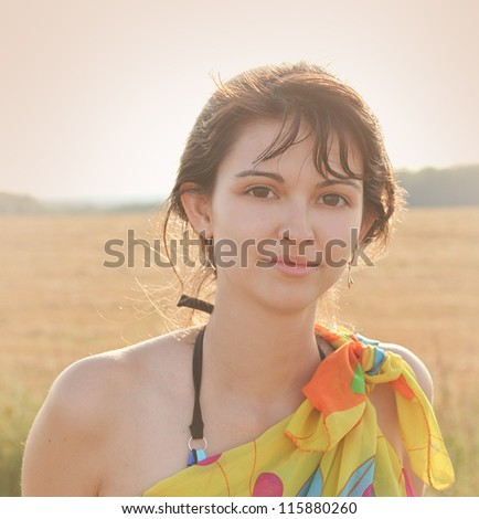 portrait of pretty beautiful young girl in the evening sunshine in nature