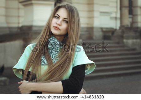 Portrait of pretty blonde woman in a coat. Closeup shot - stock photo