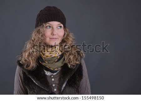 Portrait of pretty blonde woman in winter clothes