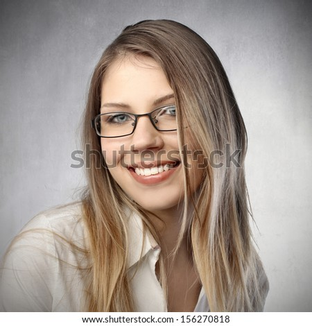 portrait of pretty blonde woman with glasses - stock photo