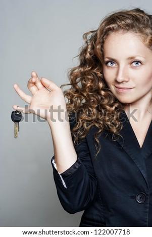 Portrait of pretty business woman with keys - stock photo