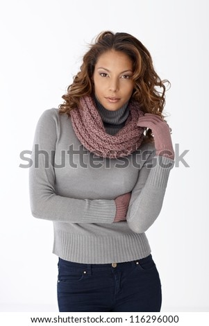 Portrait of pretty casual woman in scarf and gloves over white background.