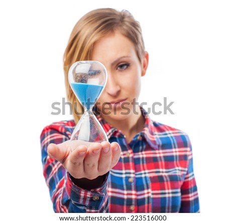 portrait of pretty girl holding a hourglass - stock photo