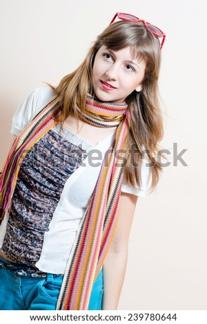 portrait of pretty girl in jeans, white t-shirt, scarf & sunglasses on the head - stock photo