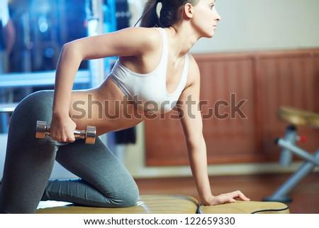 Portrait of pretty girl training in gym - stock photo