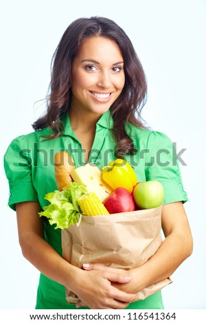 Portrait of pretty girl with big paper sack full of healthy food in isolation - stock photo