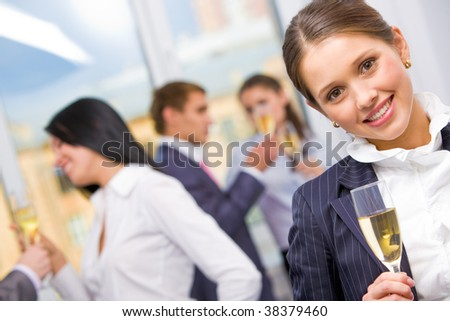 Portrait of pretty girl with champagne flute looking at camera and smiling - stock photo
