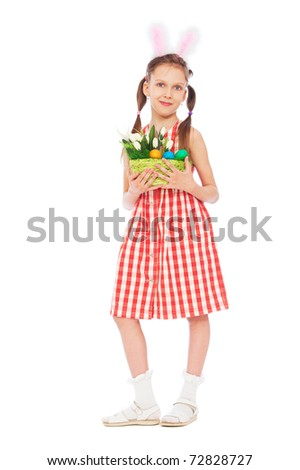 portrait of pretty girl with easter eggs and bunny's ears - stock photo