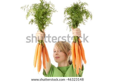 Portrait of pretty girl with ripe carrots over white background - stock photo