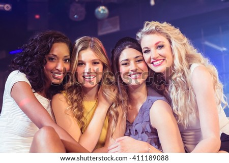 Portrait of pretty girls smiling in a nightclub