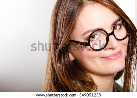 Portrait of pretty gorgeous woman in black stylish glasses