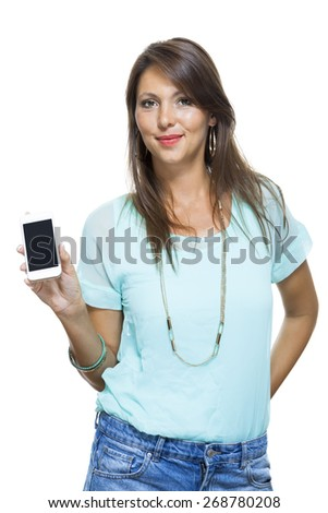 Portrait of Pretty Happy Woman in Casual Clothing Looking Something at her Mobile Phone on Hand. Captures in Studio with White Background.