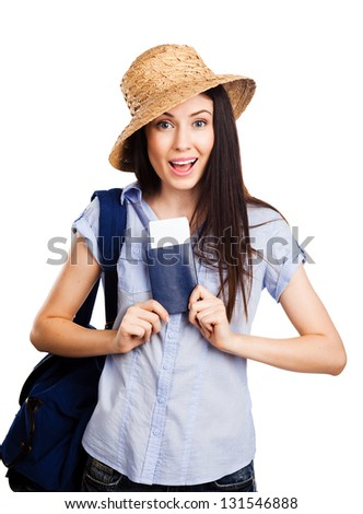Portrait of pretty happy young woman holding passport on holiday, on white background - stock photo
