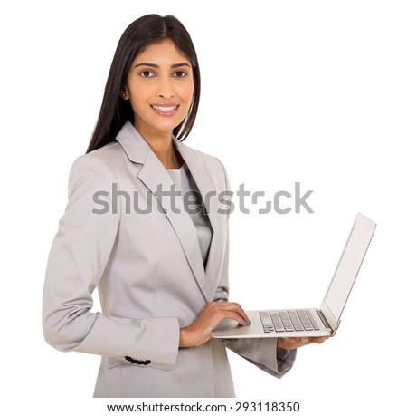 portrait of pretty indian businesswoman using laptop computer - stock photo