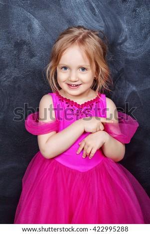 Portrait of pretty little girl in a beautiful dress - stock photo