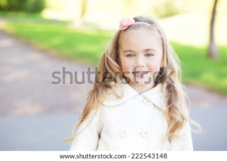 Portrait of pretty little girl outdoors - stock photo