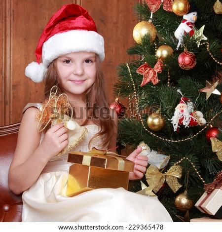 Portrait of pretty school girl decorating Christmas tree - stock photo