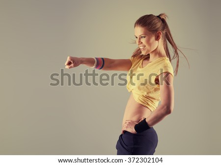 Portrait of pretty smiling athletic female dancing zumba aerobics in the gym. Concept of sport, dance and lifestyle. - stock photo