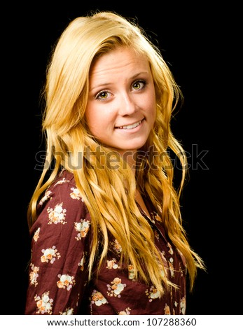 Portrait of pretty smiling happy teenage girl isolated on black