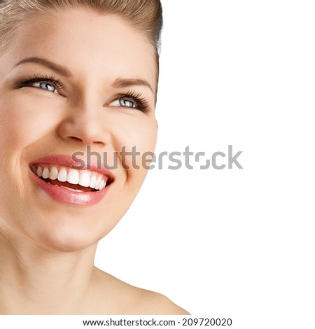 Portrait of pretty smiling woman with perfect white teeth with space for text. Young beautiful Caucasian female model with healthy smile posing in studio over white background. - stock photo