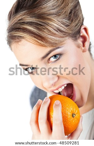 Portrait of pretty smiling young blond woman holding an orange; isolated on white; - stock photo