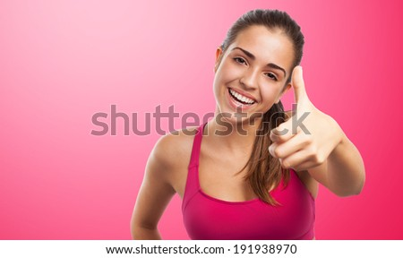 portrait of pretty sporty girl doing a positive gesture - stock photo