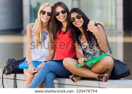 Portrait of pretty student girls having fun at the park after school  - stock photo