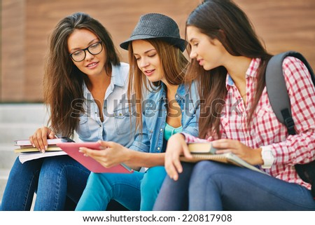 Portrait of pretty teen girls using touchpad - stock photo