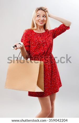 Portrait of pretty woman hold shopping bag. Female model isolated studio background. - stock photo