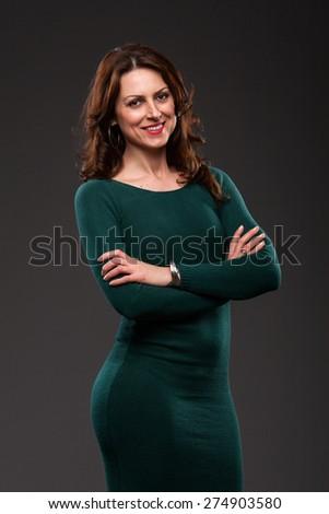 Portrait of pretty woman in green dress. - stock photo
