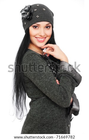 portrait of pretty woman in hat over white background - stock photo
