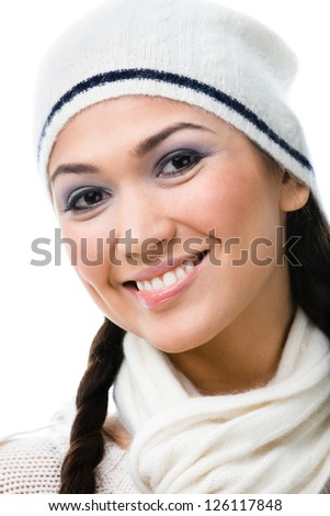 Portrait of pretty woman in white knitted cap, isolated on white