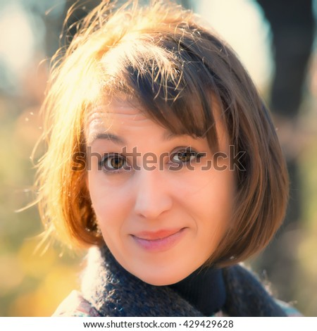 portrait of pretty woman on a sunny day in the park, the age of forty-five years - stock photo
