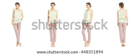 Portrait of pretty woman on white background wearing trousers
